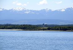 Comox Airport Tower And The Strathcona Mountain Range In The Background, Vancouver Island Royalty Free Stock Image