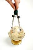Compás en el globo Imagenes de archivo