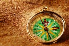Compás en la arena Imagen de archivo libre de regalías
