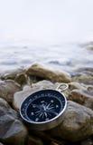 Compás en la costa Imagen de archivo libre de regalías