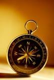Compás magnético de cobre amarillo Imagen de archivo libre de regalías
