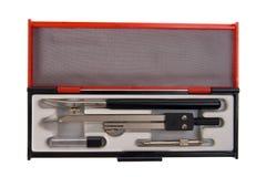 Compás y caja de herramientas de elaboración aislados Imagen de archivo libre de regalías