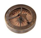 Compás y reloj de sol de cobre amarillo antiguos fotos de archivo