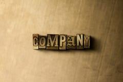 COMPAÑÍA - primer de la palabra compuesta tipo vintage sucio en el contexto del metal Fotografía de archivo libre de regalías