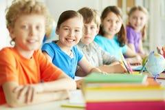 Compañeros de clase en la lección Imagen de archivo libre de regalías