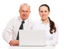 Compañeros de trabajo con la computadora portátil Foto de archivo libre de regalías