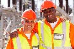 Compañeros de trabajo eléctricos de la compañía Foto de archivo libre de regalías