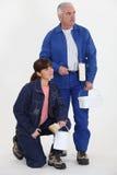 Compañeros de trabajo listos para pintar Foto de archivo libre de regalías
