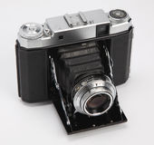 Compact camera. Old compact camera on a white background Royalty Free Stock Images