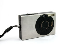 Compact camera. Frontal view of a point and shoot digital camera royalty free stock photos