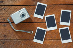 Compact camera and empty instant photo frames Stock Photos