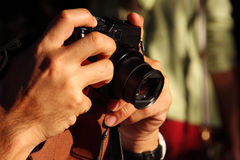 Compact camera, hand on. Stock Photo