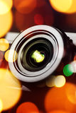 Compact camera lens with bokeh light Royalty Free Stock Photo