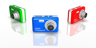 Compact Cameras. Colorful cameras isolated on white background Royalty Free Stock Photo