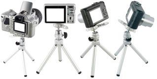 Compact cameras on tripod set royalty free stock photos