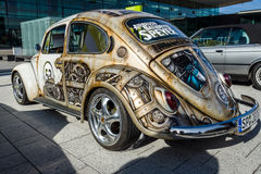 Compact car Volkswagen Beetle in unusual body painting aerography. STUTTGART, GERMANY - MARCH 04, 2017: Compact car Volkswagen Beetle in unusual body painting Royalty Free Stock Photography