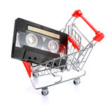 Compact casette in shopping cart isolated Royalty Free Stock Photography
