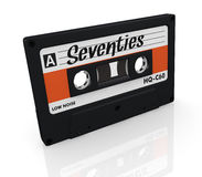 Compact cassette. One compact cassette with text: seventies, on the label (3d render Royalty Free Stock Photos