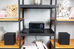 Compact CD radio player on the shelf in vintage interior royalty free stock photo