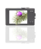 Compact digital camera. The display - Christmas photo. Isolated object. Reflection at the bottom of a white background Stock Photos