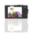 Compact digital camera. The display - Christmas photo. Isolated object Stock Image