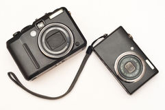 Compact digital camera. Different size of compact digital cameras Royalty Free Stock Images