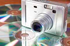 Compact digital camera and cd Royalty Free Stock Photography