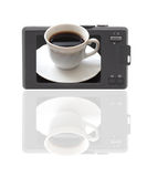 Compact digital camera. The display-cup of coffe. Compact digital camera. The display - cup of coffe. Reflection at the bottom of a white background. Isolated Royalty Free Stock Image