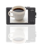 Compact digital camera. The display-cup of coffee. Compact digital camera. The display - cup of coffe. Reflection at the bottom of a white background. Isolated Stock Image
