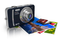 Compact digital camera and photos Stock Photography