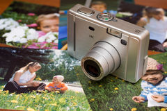 Compact digital camera and photos Royalty Free Stock Image