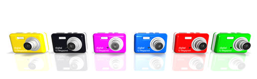 Compact Digital Cameras. Colorful cameras on white background Royalty Free Stock Photography