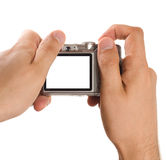Compact digital photo camera held in hands Royalty Free Stock Photos