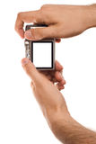 Compact digital photo camera held in hands Stock Photos