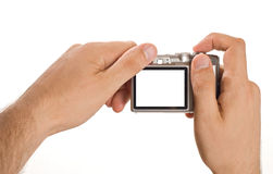 Compact digital photo camera held in hands Royalty Free Stock Image