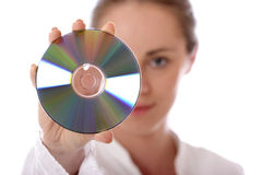 Compact disc. Stock photo of a young woman holding compact disc Royalty Free Stock Image