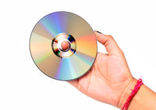 Compact disc. Female hand holding compact disc isolated on white background Stock Photography