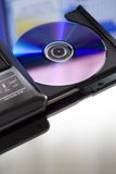 Compact disc and cd dvd recorder. Close up Royalty Free Stock Photos