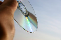 Compact disc close-up against the sky background stock photos