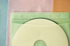 Compact disc in color bag Stock Images