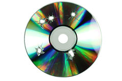 Compact disc com os furos dos tiros Fotos de Stock Royalty Free