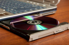 Compact disc on drive Royalty Free Stock Photo