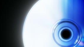 Compact disc em um fim preto do fundo acima do laço sem emenda vídeos de arquivo