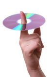 Compact disc on a finger. Isolated Royalty Free Stock Photo