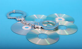 compact disc and handcuffs Royalty Free Stock Image