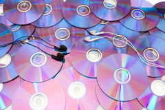 Compact disc and headphones Stock Images