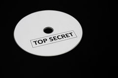 Compact disc with label of top secret on black background Stock Photo