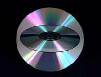 Compact Disc Overlay. Compact discs overlayed against black background Royalty Free Stock Photos