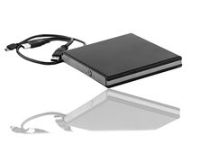 Compact disc rewritable. Portable slim external CD DVD burner writer isolated on white Royalty Free Stock Photography
