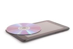 Compact disc on a tablet PC (Clipping path) Royalty Free Stock Photo